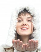young woman with long brown hair  in fur white hat.isolated on white