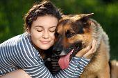 image of sheep-dog  - Portrait of a girl hugging shepherd dog with love  - JPG