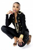 Young Beautiful African Woman Wearing a Black Jacket Golden Jewellery and Pink Lips, Fashion, Studio