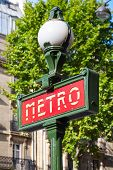 Street Sign At The Entrance To The Paris Metro