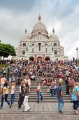 Crowd Of Tourists Near Sacre Coeur Basilica In Paris