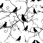 Birds on swirling branches seamless pattern