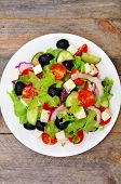 Greek salad in a white plate