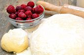 dough, rolling pin and mincemeat cherries