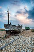 Wooden Fishing Boats On A Pebble Beach