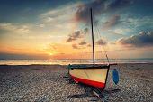 Vintage Effect Sailing Boat At Sunset