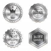 picture of exclusive  - Silver metal badges isolated on white background - JPG