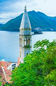 stock photo of yugoslavia  - The St Ilya hill overlooks the Kotor bay with the tiny islets and the roofs of the old town of Perast Montenegro - JPG