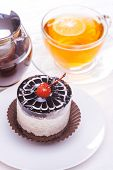 Delicious Of Cherry Tea Cake On Wooden Table