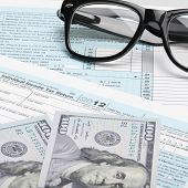 Usa Tax Form 1040 With Glasses, And 100 Us Dollar Bills