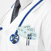 Doctor With Money In His Pocket - Closeup Shot