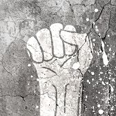 Grunge fist illustration on concrete texture with white splashes. Vector