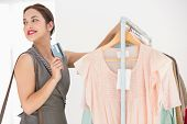 Beauty brunette leaning rail and holding credit card at clothes store