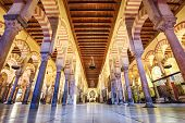 CORDOBA, SPAIN - CIRCA 2014: Hypostle Hall in the Mosque-Cathedral of Cordoba. The site has a rich religious history and is currently an active cathedral.