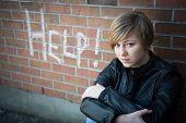 Depressed, sad girl outside school