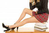 School Girl Legs Sit On Books