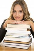 School Girl With Stack Of Books Serious