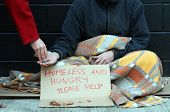pic of scourge  - Homeless man holds out hand - JPG