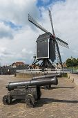 Two Cannons And Mill