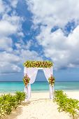 wedding arch and set up on beach, tropical outdoor wedding cabana on beach