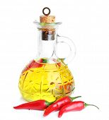 Homemade natural infused olive oil with red chili peppers isolated on white