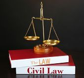 Books of Law on table on dark background