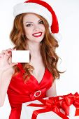 Beautiful Snow Maiden with a credit card and a gift in their hands.
