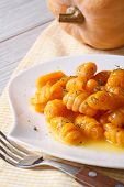 Pumpkin Gnocchi With Sauce And Spices On The Plate, Vertical