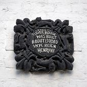 pic of reign  - Wooden plaque on the front of the Tudor House along Bridge Street which was built about 1503AD in the reign of Henry VII Chester Cheshire England UK Western Europe - JPG