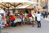 People Are Resting In Outdoor Cafe At The Center Verona, Italy