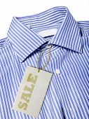 blue shirt with paper tag sale