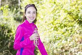 Fitness Woman With A Water Bottle In Her Hand During Sports