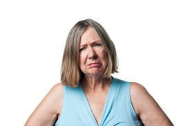 stock photo of saddening  - Older woman upset saddened and disappointed by some news - JPG