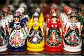 foto of traditional dress  - Traditional handmade toys puppets dolls in symbolic artistic dress - JPG