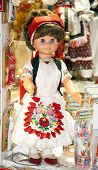 foto of dress-making  - Traditional handmade toys puppets dolls in symbolic artistic dress - JPG