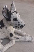 stock photo of spotted dog  - A black and white spotted dog statue - JPG