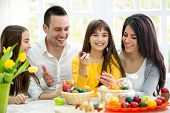 foto of happy easter  - Happy family have fun with Easter eggs - JPG
