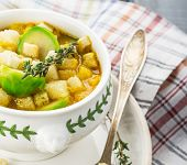 picture of brussels sprouts  - Homemade soup with brussels sprouts and croutons in white bowl decorated with a sprig of thyme - JPG