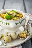 foto of brussels sprouts  - Homemade soup with brussels sprouts and croutons in white bowl decorated with a sprig of thyme - JPG