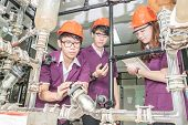 picture of pipeline  - Engineer student turning pipeline pump for training in laboratory - JPG