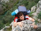 image of paysage  - athletic young man under the sun on the background of the mountain massif - JPG