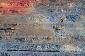 image of open-pit mine  - iron ore open pit mining quarry red gray brown - JPG
