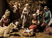 picture of three kings  - The baby Jesus lies in a manger watched over by his mother Mary her husband Joseph a lowly shepherd the three wise men and animals in the stable at Bethlehem - JPG