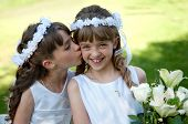 stock photo of communion  - Young girls doing her catholic first holy communion - JPG