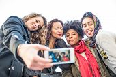 foto of mans-best-friend  - Group of attractive young women of different ethnics taking a selfie  - JPG