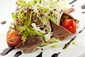 stock photo of tongue  - Beef Tongue Salad with Fresh Vegetables and Balsamic Sauce - JPG