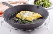 stock photo of cod  - smoked cod with thyme and rosemary in a cast iron pan - JPG