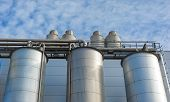 stock photo of silo  - Detail of chemical plant silos and pipes - JPG