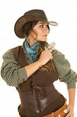 stock photo of pistols  - a cowgirl with a pistol looking over her shouldler with a serious expression - JPG
