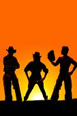 picture of cowboys  - a silhouette of a cowgirl in the middle of two cowboys in the outdoors - JPG